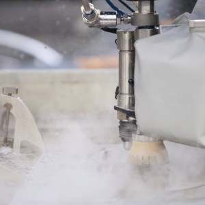 Automated waterjet metal cutting machine in action